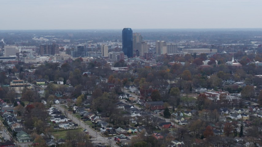 5.7K stock footage aerial video of city skyline while flying by neighborhoods, Downtown Lexington, Kentucky Aerial Stock Footage | DX0001_003228
