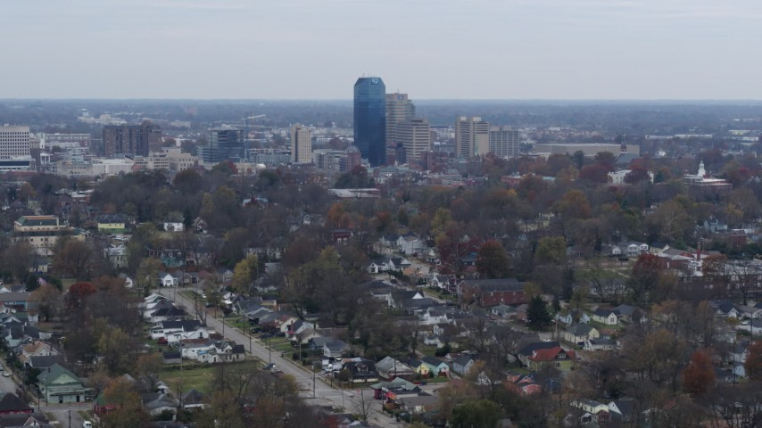 5.7K stock footage aerial video of city skyline while passing by neighborhoods, Downtown Lexington, Kentucky Aerial Stock Footage | DX0001_003229