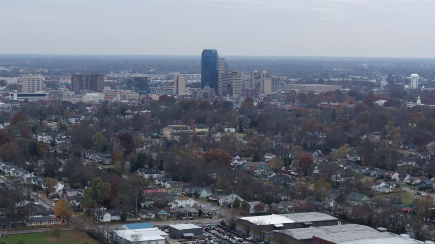 5.7K stock footage aerial video of city skyline while flying by houses, Downtown Lexington, Kentucky Aerial Stock Footage | DX0001_003230