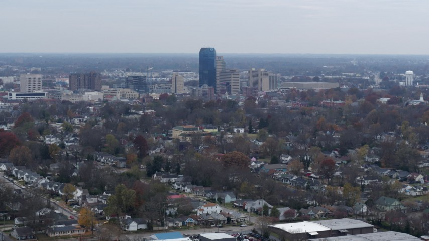 5.7K stock footage aerial video of city skyline while flying by tree-lined neighborhoods, Downtown Lexington, Kentucky Aerial Stock Footage | DX0001_003231
