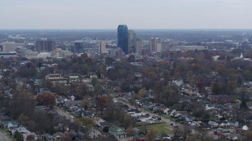 5.7K stock footage aerial video of city skyline while flying past tree-lined neighborhoods, Downtown Lexington, Kentucky Aerial Stock Footage | DX0001_003232