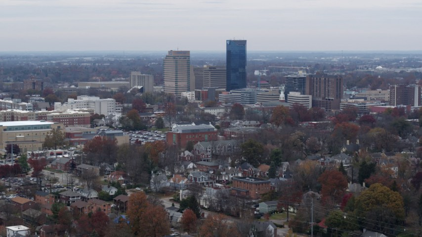 5.7K aerial video of flying by skyscrapers in the city skyline, seen from neighborhoods, Downtown Lexington, Kentucky Aerial Stock Footage | DX0001_003244