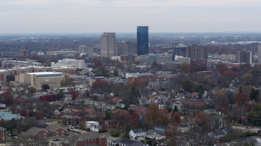 5.7K stock footage aerial video of passing by skyscrapers in the city skyline, seen from neighborhoods, Downtown Lexington, Kentucky Aerial Stock Footage | DX0001_003245