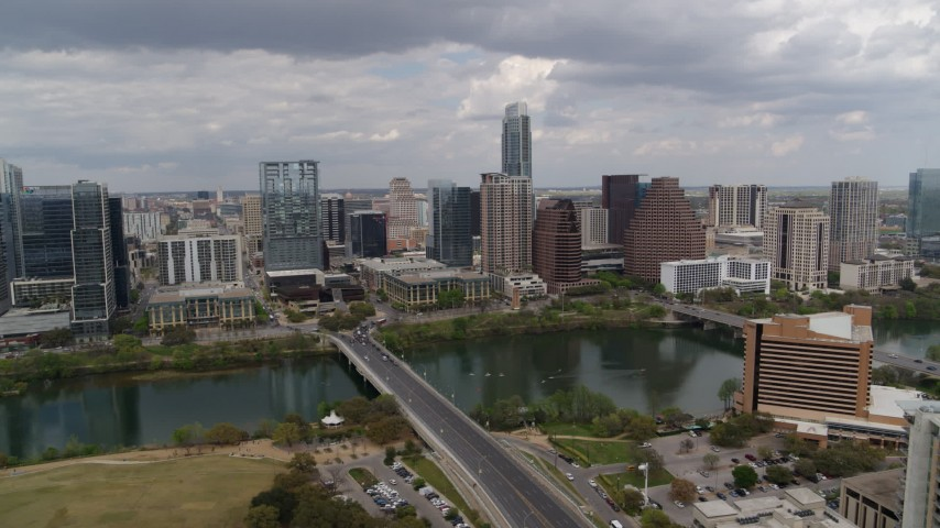 5.7K stock footage aerial video of First Street Bridge spanning Lady Bird Lake with view of skyline, Downtown Austin, Texas Aerial Stock Footage | DX0002_102_006