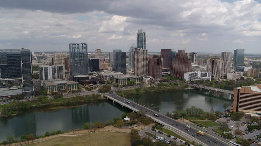 5.7K stock footage aerial video of the city skyline seen from across Lady Bird Lake, Downtown Austin, Texas Aerial Stock Footage | DX0002_102_007