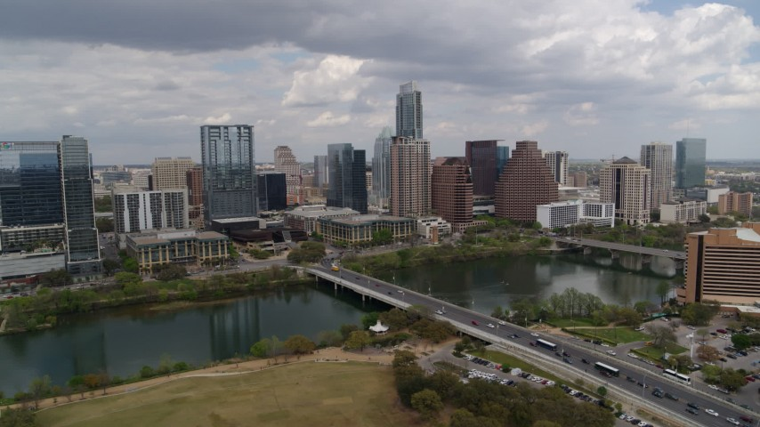 5.7K stock footage aerial video of First Street Bridge and Lady Bird Lake with view of the city skyline, Downtown Austin, Texas Aerial Stock Footage | DX0002_102_008