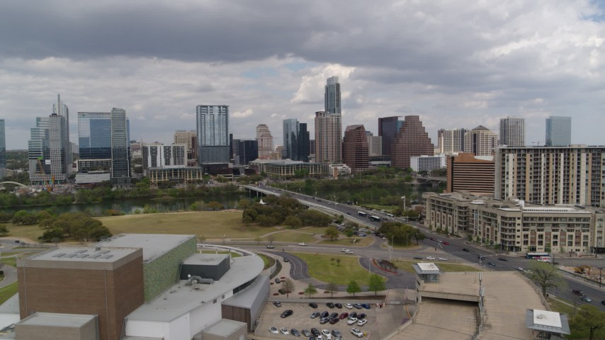5.7K stock footage aerial video approach First Street Bridge, Lady Bird Lake, and the city skyline, Downtown Austin, Texas Aerial Stock Footage | DX0002_102_010