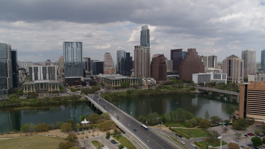 5.7K stock footage aerial video descend near First Street Bridge and Lady Bird Lake with view of skyline, Downtown Austin, Texas Aerial Stock Footage | DX0002_102_011