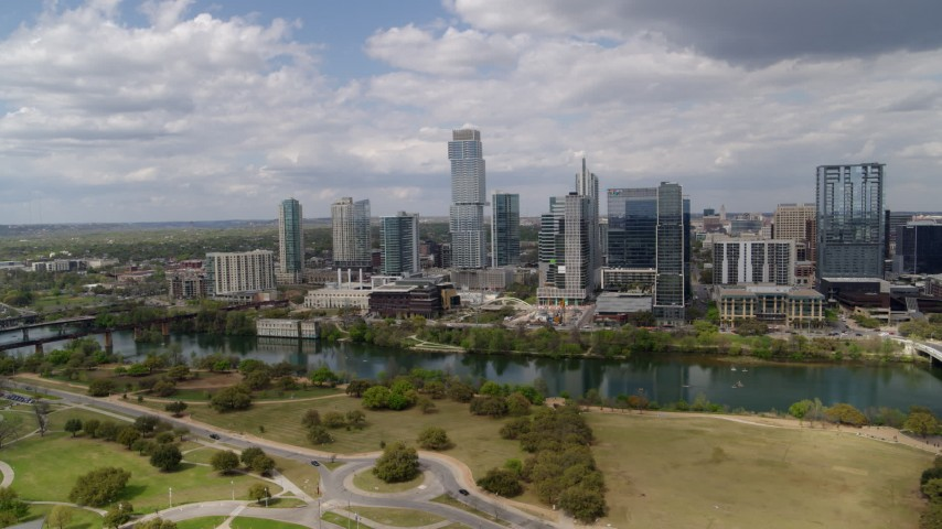 5.7K aerial video of a view of city skyscrapers across Lady Bird Lake, Downtown Austin, Texas Aerial Stock Footage | DX0002_102_012