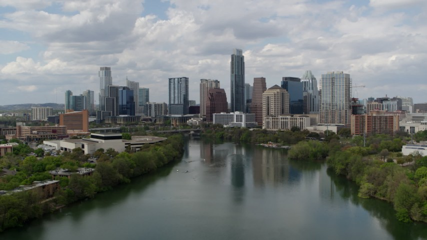 5.7K stock footage aerial video of a view of the city skyline from Lady Bird Lake, Downtown Austin, Texas Aerial Stock Footage | DX0002_102_015