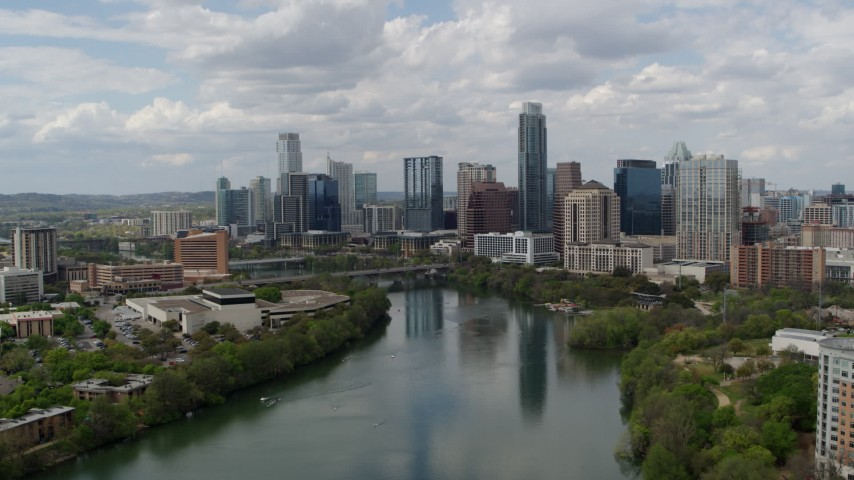 5.7K aerial video approach the city skyline from Lady Bird Lake, Downtown Austin, Texas Aerial Stock Footage | DX0002_102_016