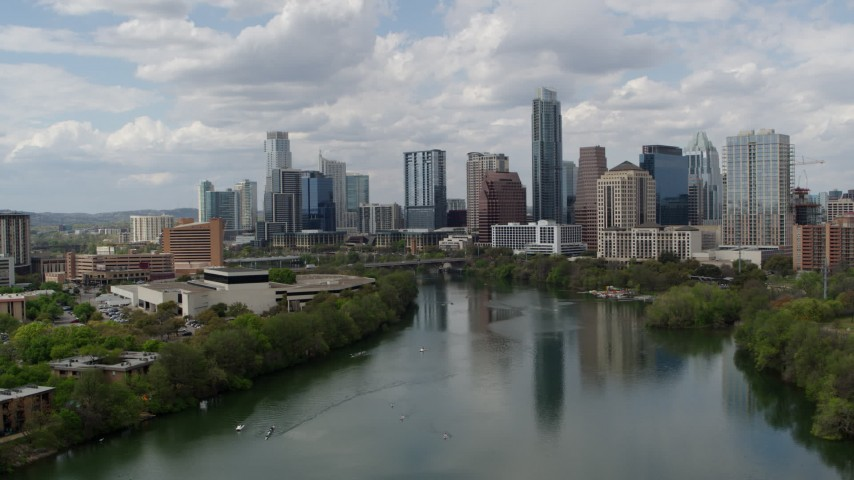 5.7K stock footage aerial video of a reverse view of the city skyline from Lady Bird Lake, Downtown Austin, Texas Aerial Stock Footage | DX0002_102_017