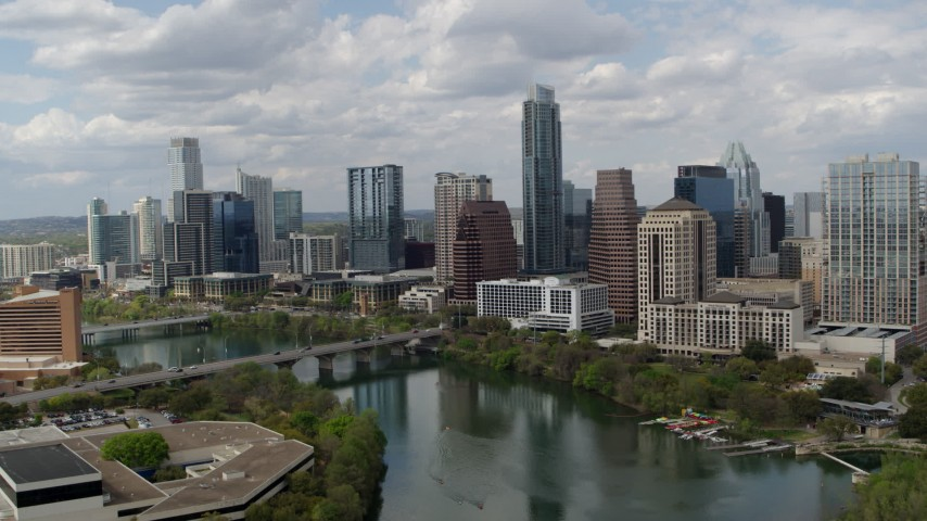 5.7K aerial video approach the city skyline from Lady Bird Lake and ascend, Downtown Austin, Texas Aerial Stock Footage DX0002_102_018