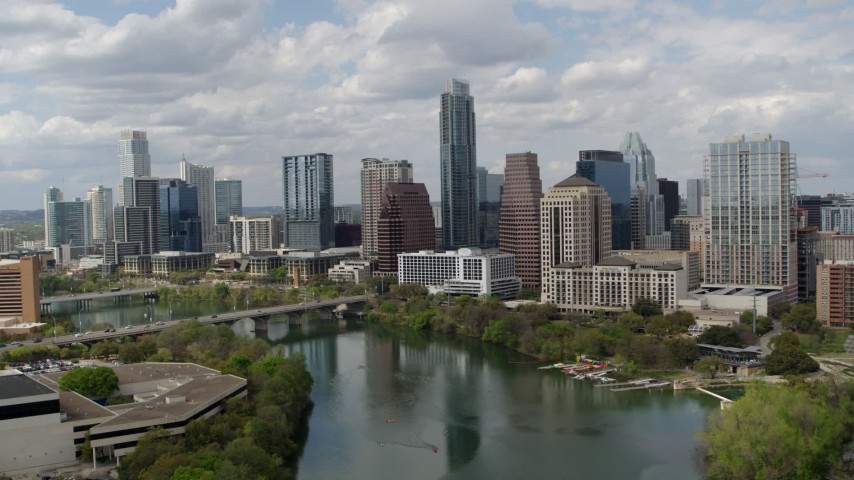 5.7K stock footage aerial video of flying away from the city skyline from Lady Bird Lake, Downtown Austin, Texas Aerial Stock Footage | DX0002_102_019