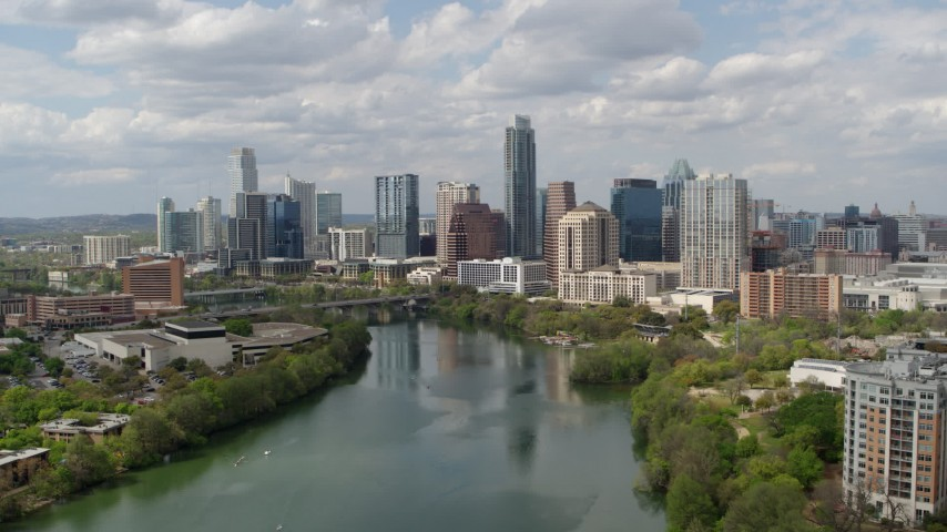 5.7K aerial video fly toward the city skyline from Lady Bird Lake, Downtown Austin, Texas Aerial Stock Footage | DX0002_102_021