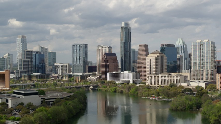 5.7K stock footage aerial video a view of skyscrapers in Downtown Austin, Texas from Lady Bird Lake Aerial Stock Footage DX0002_103_003