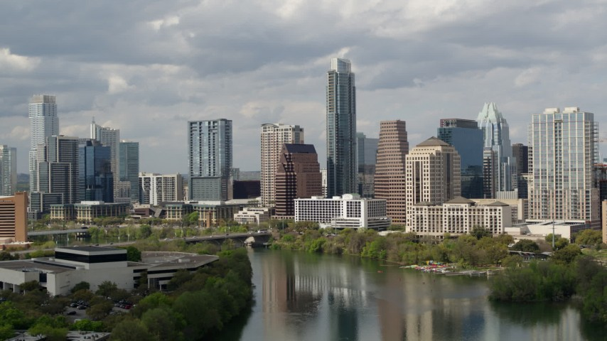 5.7K stock footage aerial video a view of skyscrapers in Downtown Austin, Texas while flying over Lady Bird Lake Aerial Stock Footage DX0002_103_004