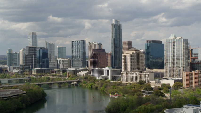 5.7K stock footage aerial video a view of skyscrapers in Downtown Austin, Texas while ascending over Lady Bird Lake Aerial Stock Footage | DX0002_103_005
