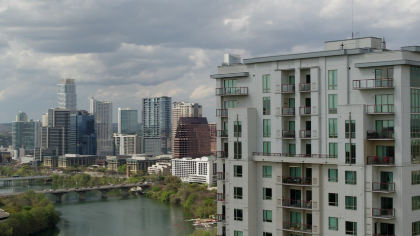 5.7K stock footage aerial video a view of skyscrapers in Downtown Austin, Texas while passing a high-rise building Aerial Stock Footage | DX0002_103_006