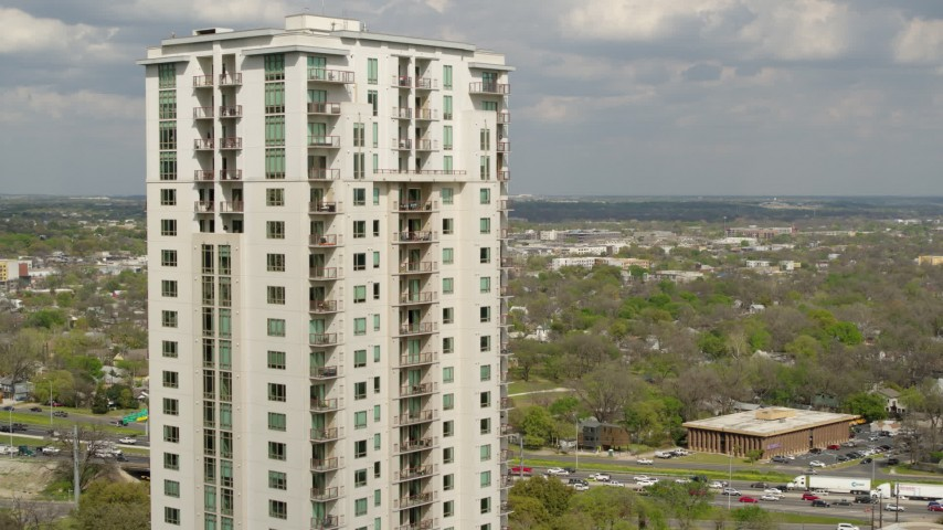 5.7K stock footage aerial video approach and flyby a high-rise apartment building in Downtown Austin, Texas Aerial Stock Footage | DX0002_103_010