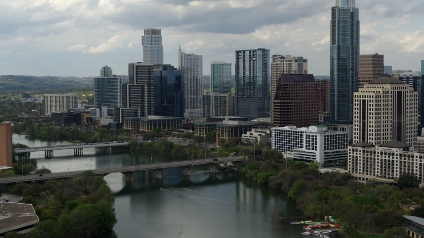 5.7K stock footage aerial video follow Lady Bird Lake toward skyscrapers in Downtown Austin, Texas Aerial Stock Footage | DX0002_103_012