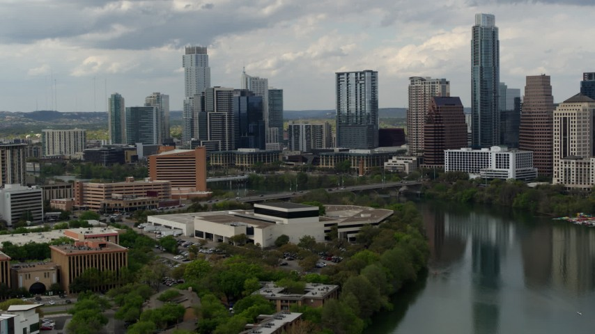 5.7K stock footage aerial video a view of waterfront skyscrapers by Lady Bird Lake in Downtown Austin, Texas Aerial Stock Footage | DX0002_103_016