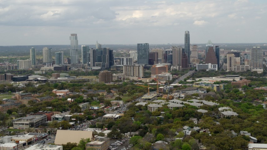 5.7K stock footage aerial video of a reverse view of the city's skyline in Downtown Austin, Texas Aerial Stock Footage | DX0002_103_018