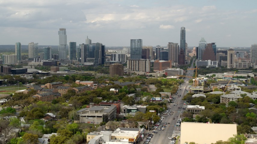 5.7K stock footage aerial video of passing Congress Avenue with view of the city's skyline in Downtown Austin, Texas Aerial Stock Footage | DX0002_103_021
