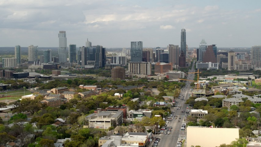 5.7K stock footage aerial video of flying near Congress Avenue with view of the city's skyline in Downtown Austin, Texas Aerial Stock Footage | DX0002_103_022