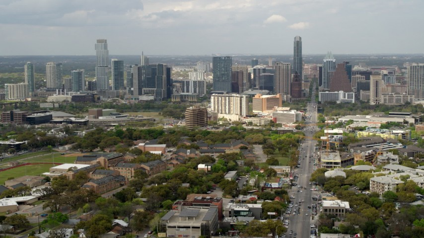 5.7K aerial video slow pass and reverse view of Congress Avenue leading to city's skyline in Downtown Austin, Texas Aerial Stock Footage | DX0002_103_024