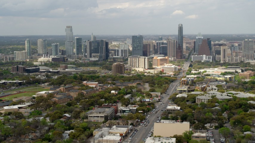 5.7K stock footage aerial video slow pass by Congress Avenue leading to city's skyline in Downtown Austin, Texas Aerial Stock Footage | DX0002_103_025
