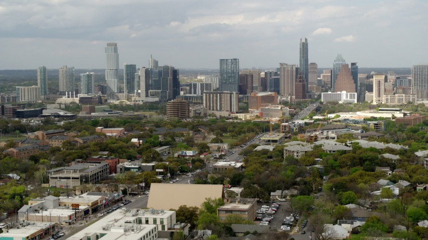 5.7K stock footage aerial video approach and ascend near Congress Avenue leading to city's skyline in Downtown Austin, Texas Aerial Stock Footage | DX0002_103_026