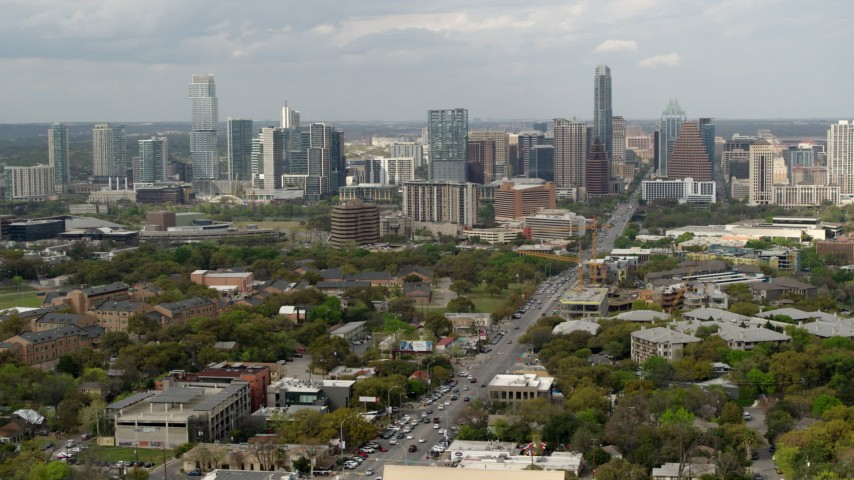 5.7K stock footage aerial video slow descent by Congress Avenue leading to city's skyline in Downtown Austin, Texas Aerial Stock Footage | DX0002_103_027