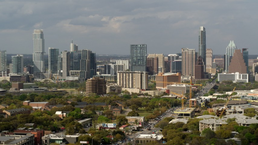 5.7K stock footage aerial video ascend for a view of the city's skyline in Downtown Austin, Texas Aerial Stock Footage | DX0002_103_028