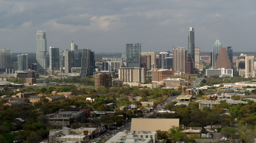 5.7K stock footage aerial video reverse view of the city's skyline in Downtown Austin, Texas, flyby Congress Avenue Aerial Stock Footage | DX0002_103_029
