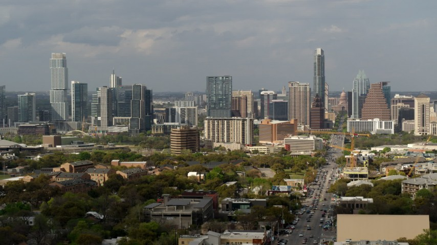 5.7K stock footage aerial video of Congress Avenue leading to the city's skyline and state capitol in Downtown Austin, Texas Aerial Stock Footage | DX0002_103_030
