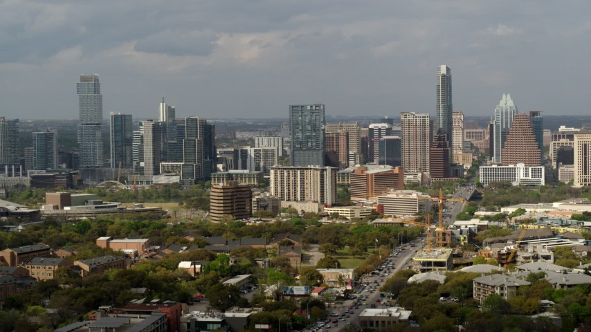 5.7K stock footage aerial video of traffic on Congress Avenue leading to the city's skyline, Downtown Austin, Texas Aerial Stock Footage | DX0002_103_031