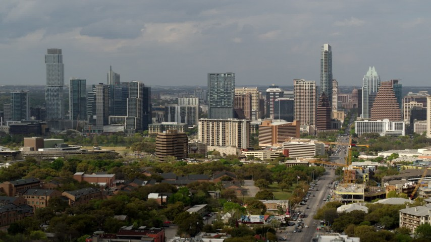 5.7K stock footage aerial video flyby Congress Avenue leading to the city's skyline and state capitol, Downtown Austin, Texas Aerial Stock Footage | DX0002_103_032