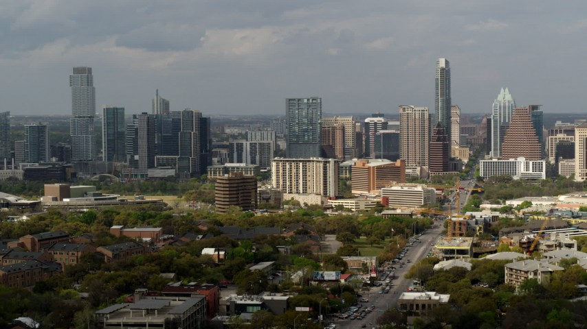 5.7K stock footage aerial video descend by Congress Avenue leading to the city's skyline and state capitol, Downtown Austin, Texas Aerial Stock Footage | DX0002_103_033