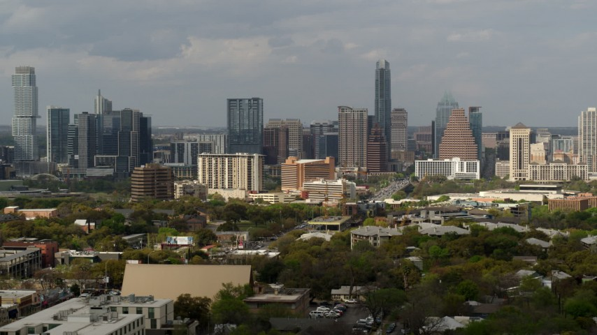 5.7K aerial video reverse view and flyby of the city's skyline, Downtown Austin, Texas Aerial Stock Footage | DX0002_103_035