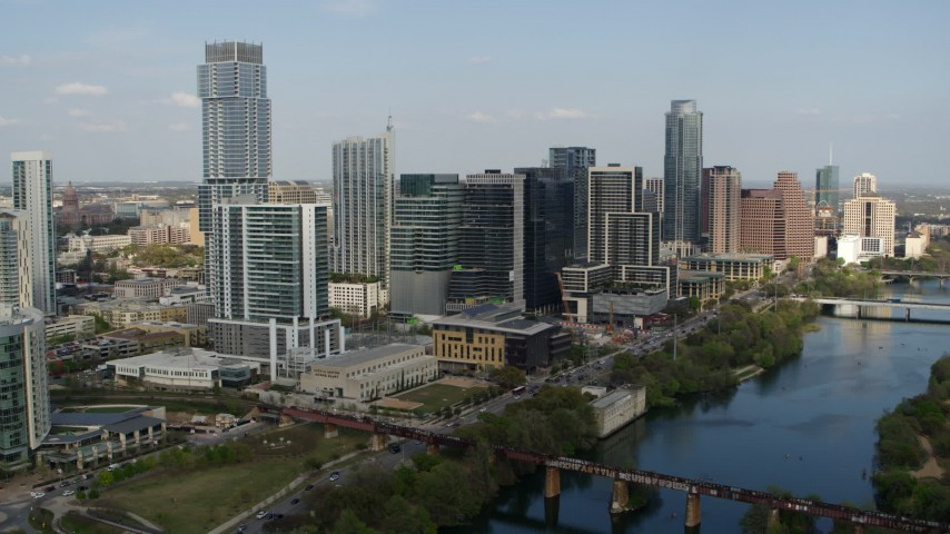 5.7K stock footage aerial video slowly flying by tall skyscrapers and bridges spanning Lady Bird Lake, Downtown Austin, Texas Aerial Stock Footage | DX0002_104_002