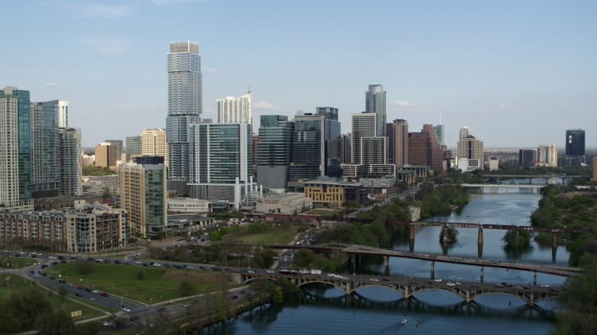 5.7K stock footage aerial video approach Lady Bird Lake with view of bridges and skyscrapers, Downtown Austin, Texas Aerial Stock Footage | DX0002_104_005