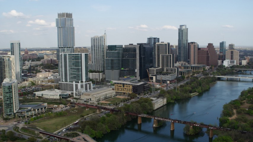 5.7K stock footage aerial video ascend and flyby towering skyscrapers and bridges over Lady Bird Lake, Downtown Austin, Texas Aerial Stock Footage | DX0002_104_011