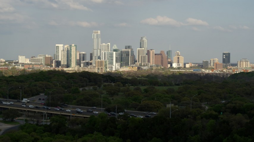 5.7K stock footage aerial video ascend from hills for wide view of city skyline, Downtown Austin, Texas Aerial Stock Footage | DX0002_104_017