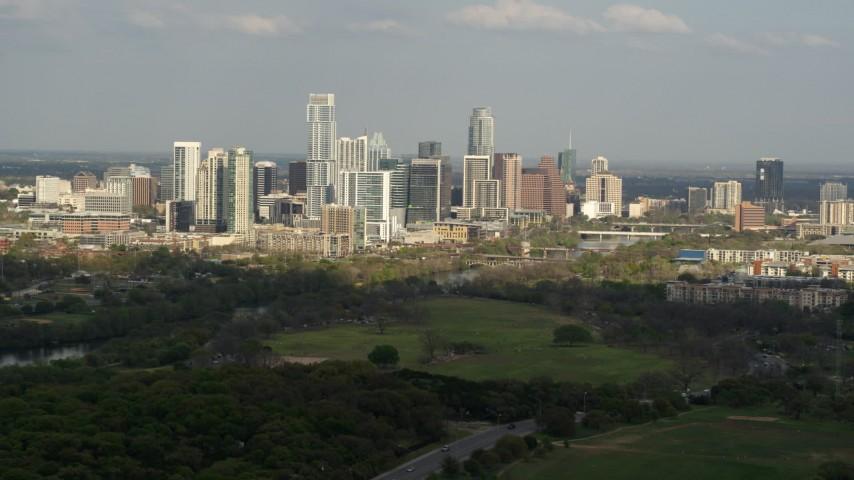 5.7K stock footage aerial video of a wide view of city skyline and Lady Bird Lake, Downtown Austin, Texas Aerial Stock Footage | DX0002_104_018