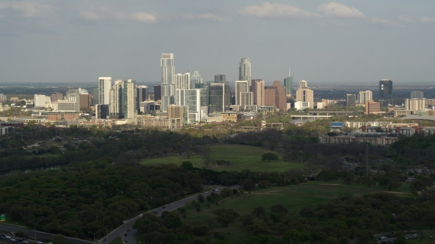 5.7K stock footage aerial video of a wide view of city's towering skyline and Lady Bird Lake, Downtown Austin, Texas Aerial Stock Footage | DX0002_104_019