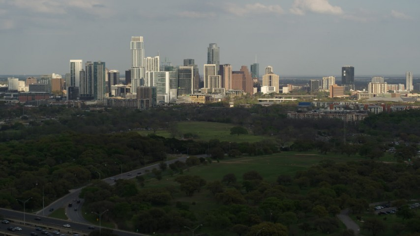 5.7K aerial video of a wide view of city's towering skyline, seen from freeway, Downtown Austin, Texas Aerial Stock Footage | DX0002_104_024