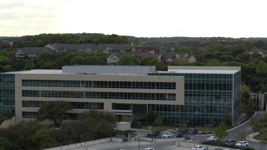 5.7K aerial video of orbiting a modern office building in Austin, Texas Aerial Stock Footage | DX0002_104_026