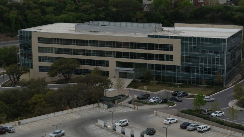 5.7K stock footage aerial video of reverse view of a modern office building in Austin, Texas Aerial Stock Footage | DX0002_104_027