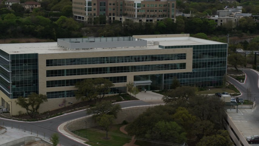 5.7K stock footage aerial video approach and orbit a modern office building in Austin, Texas Aerial Stock Footage | DX0002_104_029
